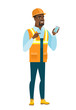 African-american builder holding a mobile phone.