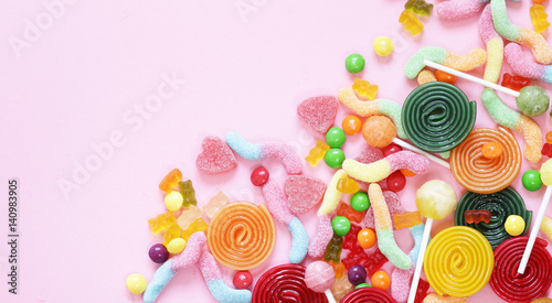 Fotografiet Colorful candy and fruit jelly jujube on a pink background