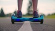 Man start moving on gyro scooter at asphalt road. Closeup of man legs on self balance hoverboard outdoors. Man riding on electric hover board at road. Modern eco transport. Man driving gyro board