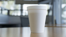 Disposable Coffee Cup On Table...