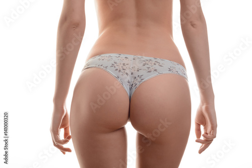 Deurstickers Ezel Closeup of a sexy woman's ass wearing in panties isolated on white background