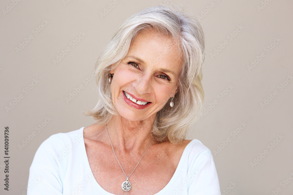 Fototapety, obrazy: beautiful older woman smiling and standing by wall