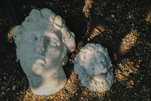 The Broken British Sculpture Is Dumped In The Ground Of Forest