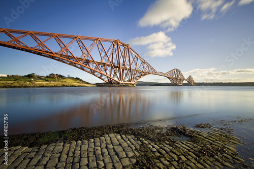 Fotografie, Obraz The Forth Rail Bridge is a cantilever railway bridge opened in 1890 that crosses the Firth of Forth between Edinburgh and Fife in Scotland