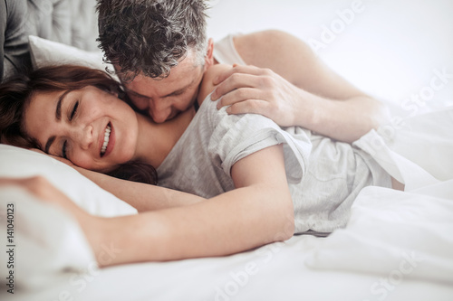 Beautiful passionate couple in bed Wallpaper Mural
