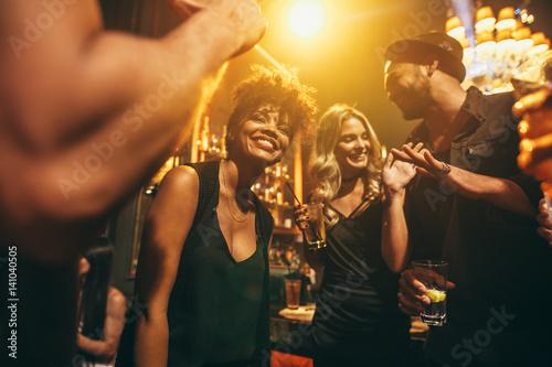 Canvas Print Happy young people having fun a nightclub