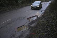 Car Approaching A Pothole