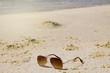 Sunglasses on the beach sand
