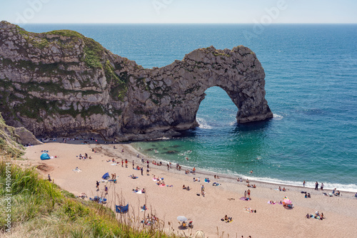 Durdle door beach in Dorset, UK on a sunny summer's day Poster