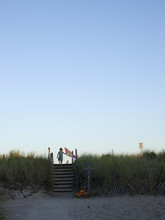 Boy Holding Kite By Sandy Beach