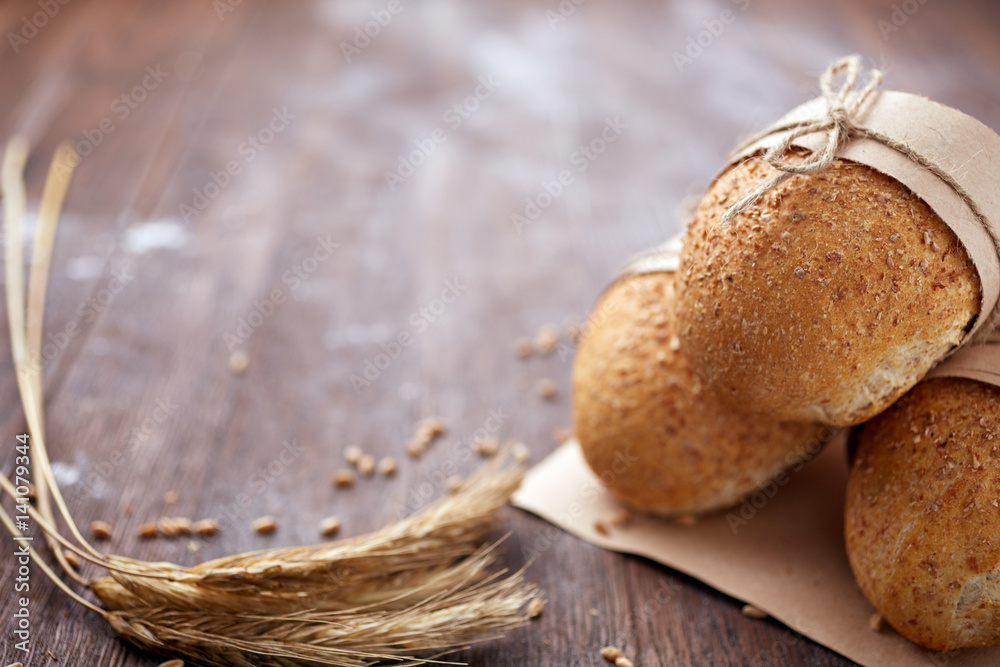 Fototapety, obrazy: Bread loaf rustic selection of rye, soda, bloomer breads, with granary and oated rolls and ears of wheat.