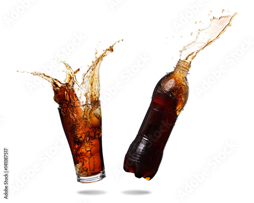 Couple cola splashing out of glass and bottle., Isolated white background.