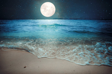 Obraz na SzkleBeautiful fantasy tropical beach with star and full moon in night skies - imagine style artwork with vintage color tone