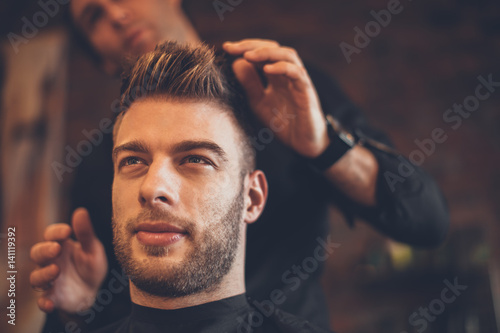 Fotografie, Obraz  Handsome man at the hairdresser getting a new haircut