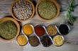Various colorful spices on wooden table. closeup. place for typography