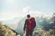 canvas print picture - Man traveling in mountains Travel Lifestyle concept adventure active summer vacations wayfaring outdoor hiking sport with red backpack