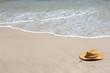 Straw hat on tropical beach