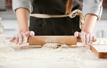 Woman Rolling Dough For Pasta On Table, Closeup