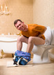 Diarrhea problem, man sitting on toilet bowl