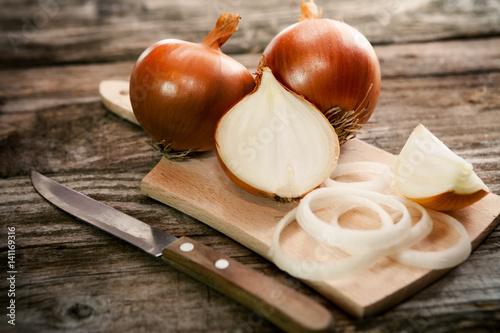 Cut fresh bulb of onion on cutting board