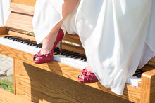 Bride With Red Shoes On Piano
