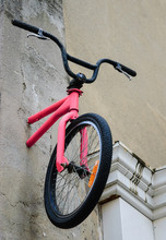 Bike Attached To The Wall In Marais Quarter Of Paris (France).