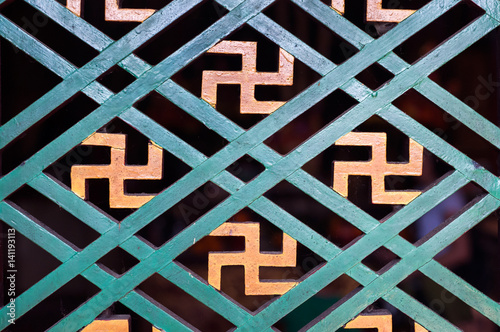 Buddhist Manji Symbol Seen In A Detail Of A Wooden Window Frame At A