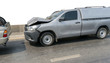Car crash from car accident on the road in a city car pickup wait insurance.