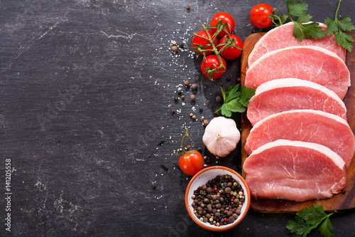 Valokuva  fresh pork with ingredients for cooking