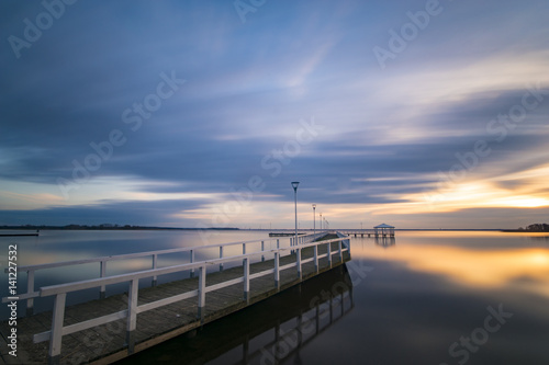 wooden pier by the sea, long exposure, evening Poster