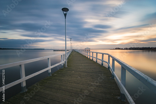 Poster Cote wooden pier by the sea, long exposure, evening