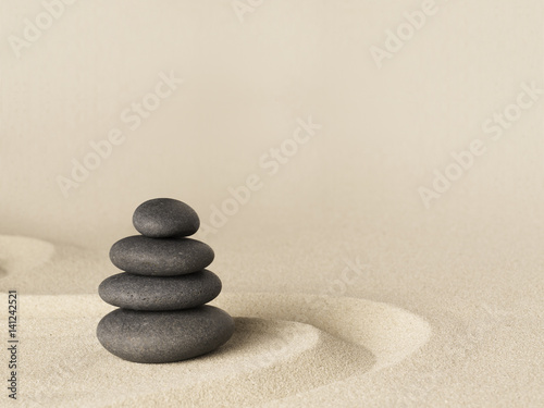 Foto-Fahne - Balance and harmony, zen stone garden background. Dark black stones on fine sand standing for concentration and relaxation.. (von kikkerdirk)
