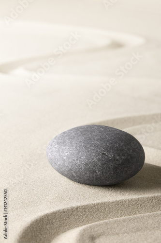 Foto op Plexiglas Stenen in het Zand Zen background with stone and line in the sand. Focus on concentration and spirituality for harmony and purity..