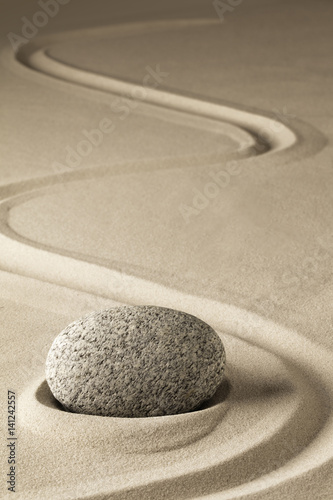 Foto op Plexiglas Stenen in het Zand zen meditation stone and sand, a spiritual japanese rock garden. Abstract harmony and balance concept for purity concentration spa relaxation...