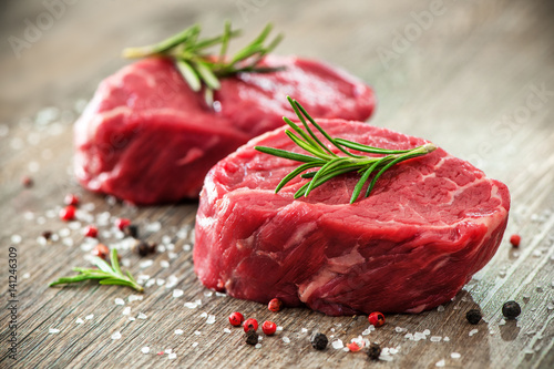 Raw beef fillet steaks with spices