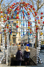 PARIS, FRANCE - APRIL, 2013: Ornate Entrance To Palais-Royal (Louvre Museum) Metro Station, Made Of Colored Glass Beads, Was Designed By Jean-Michel Othoniel.