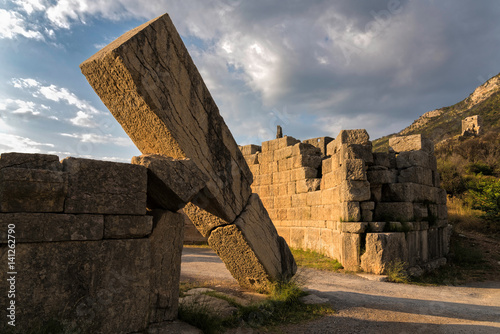 Fotografering  The famous Arcadian Gate in the archaeological site of ancient Messene in Pelopo