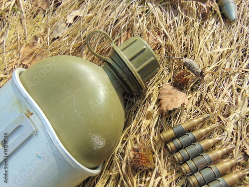 Photo  ammunition from World War 2 and drinking bottle