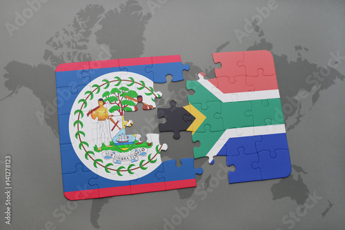 puzzle with the national flag of belize and south africa on a world on