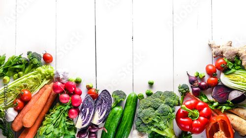 Obraz Big set organic food. Fresh raw vegetables. On a white chalkboard. - fototapety do salonu