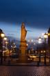 Sculpture of Saint Roland and stone bridge over Daugava river in old city Riga