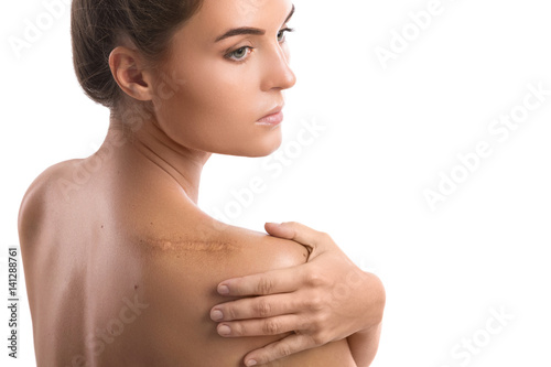 Photo Woman with a scar on her shoulder