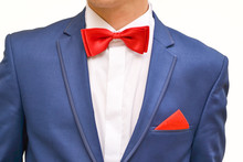 Man In Blue Suit With Red Hand...