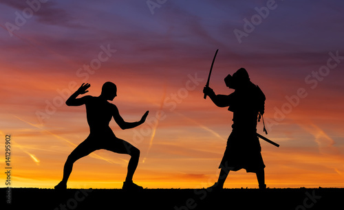 Photo  Silhouette of two samurais in duel