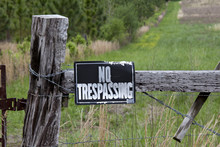 No Trespassing Sign On Weather...