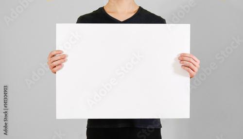 man showing blank white big a2 paper leaflet presentation pamphlet