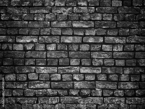Fotografia  texture of a black brick wall background gloomy background for design