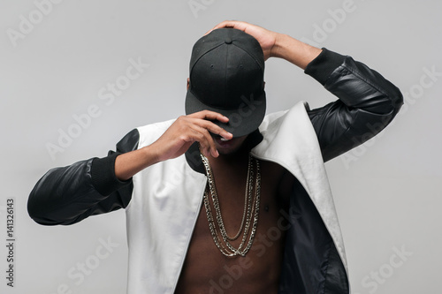 Fotografie, Obraz  Black afroamerican rebellious rapper on grey background