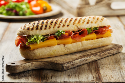 Keuken foto achterwand Snack Traditional Italian sandwich with ham and cheese served warm.
