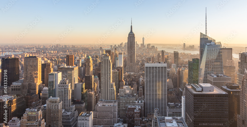 Fototapety, obrazy: New York City. Manhattan downtown skyline with illuminated Empire State Building and skyscrapers at sunset.